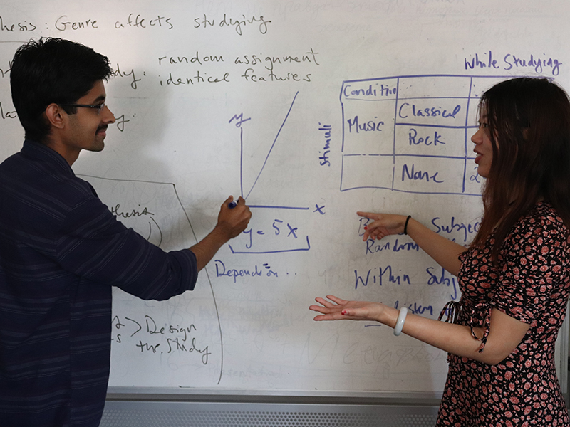 Two students discuss a theory they learned in class.