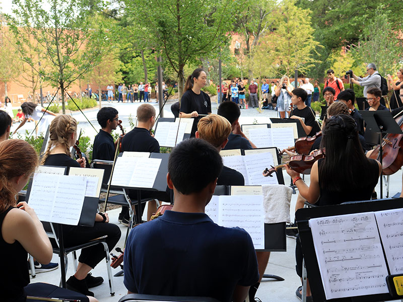 The Symphony Orchestra performing in an outdoor concert.