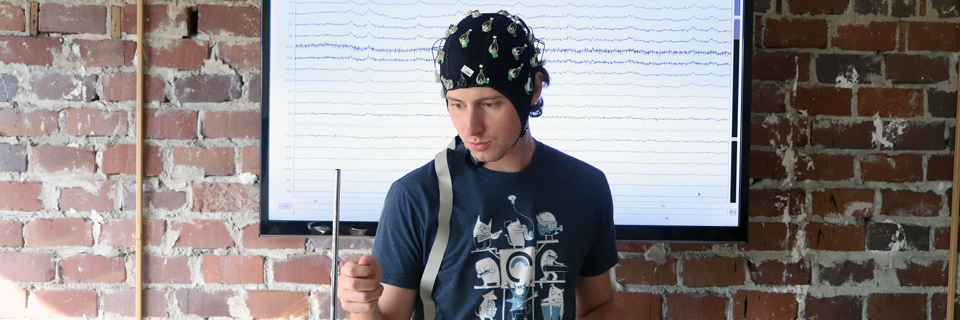 Ph.D. Mike Winters utilizing a brainscanner in an experiment.