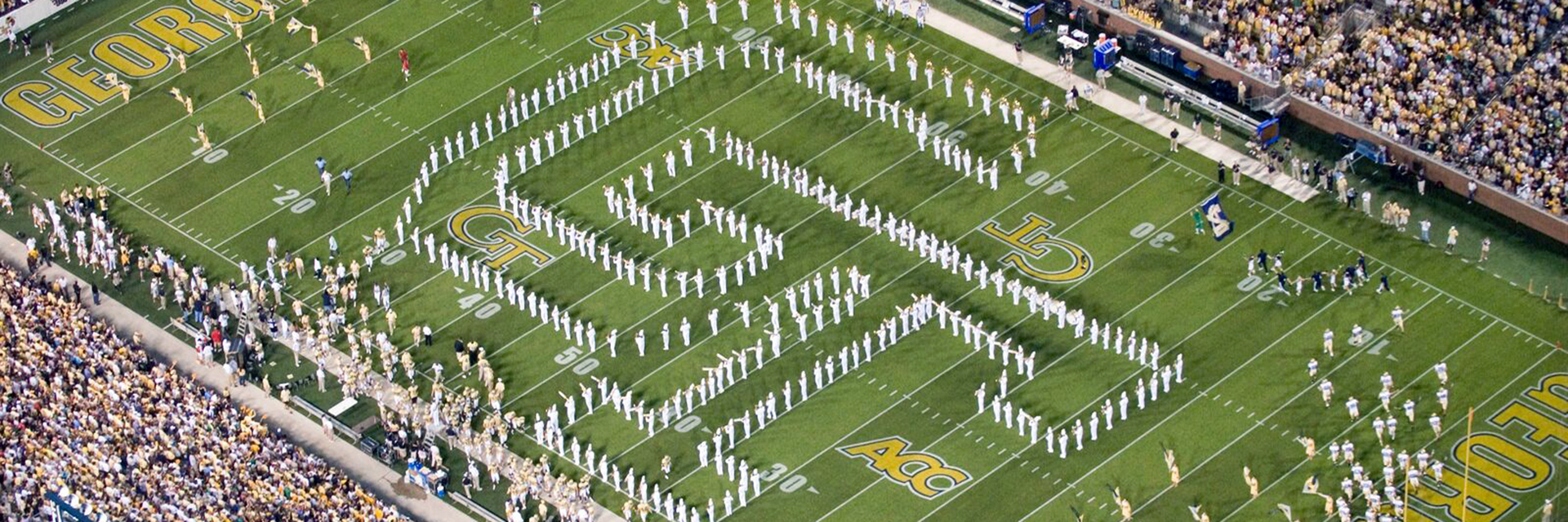 The Marching Band in formation at a football game.