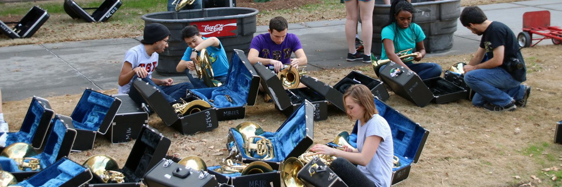 A group of students maintaining and cleaning instruments.