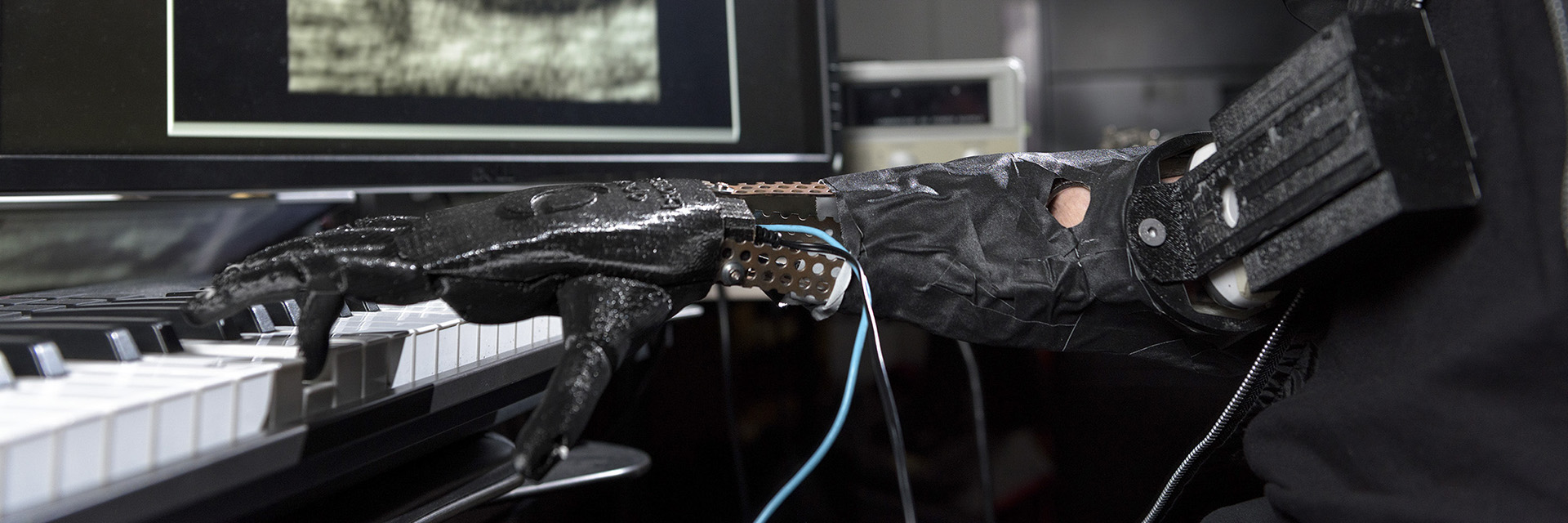 The skywalker hand, a prosthetic hand designed to help amputees play music, plays the piano.