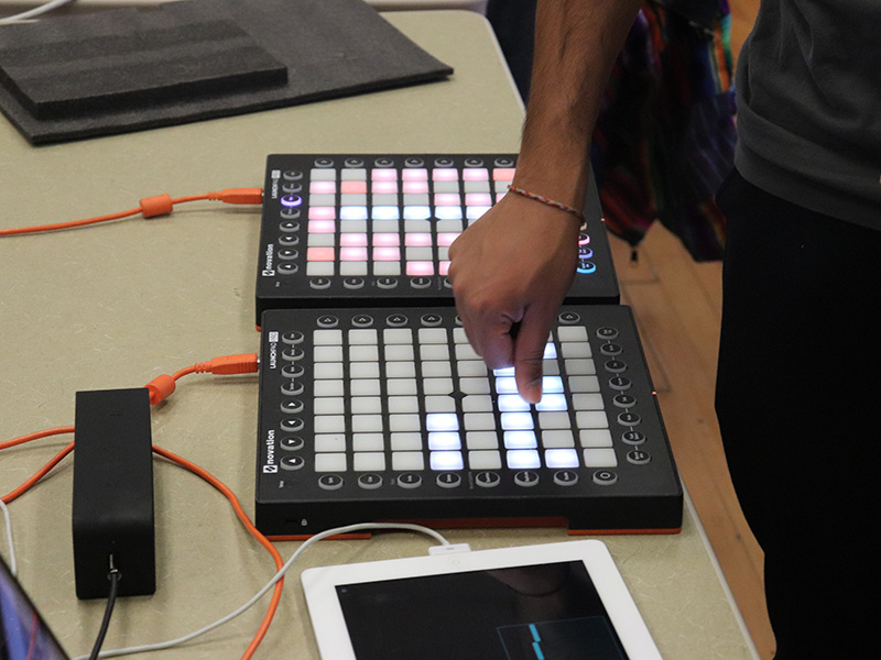 A student using mixing equipment in a class demo.