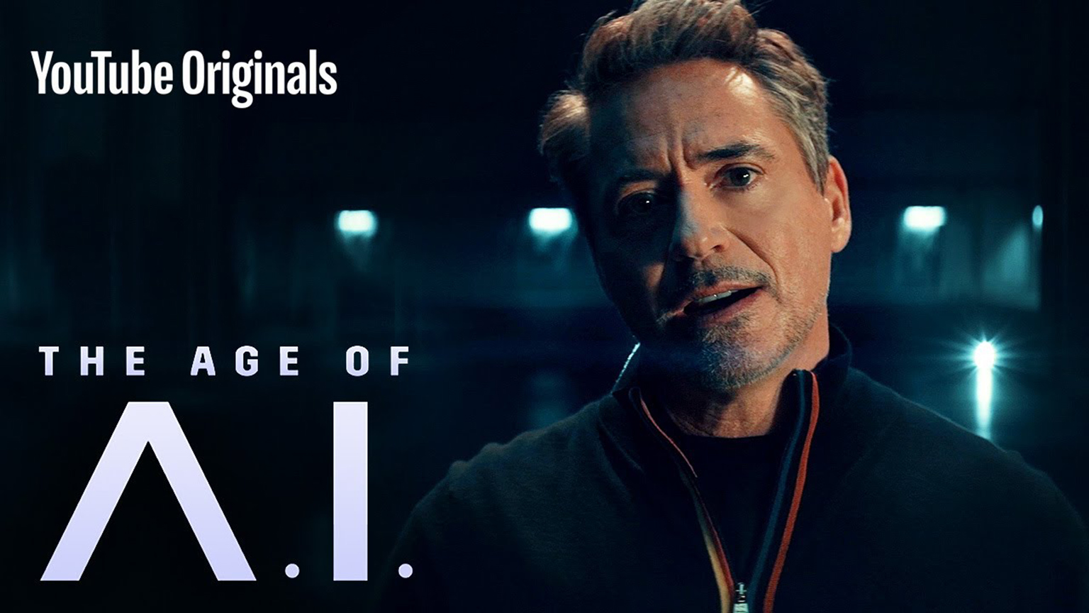 "Robert Downey Jr. featured next to a titlecard of Youtube's ""Age of AI""."