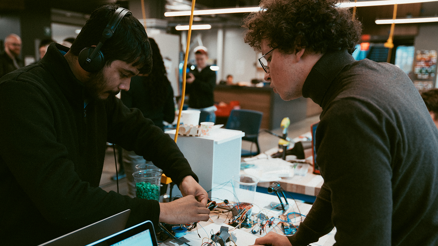 Two graduate students working on a project at a hackathon.