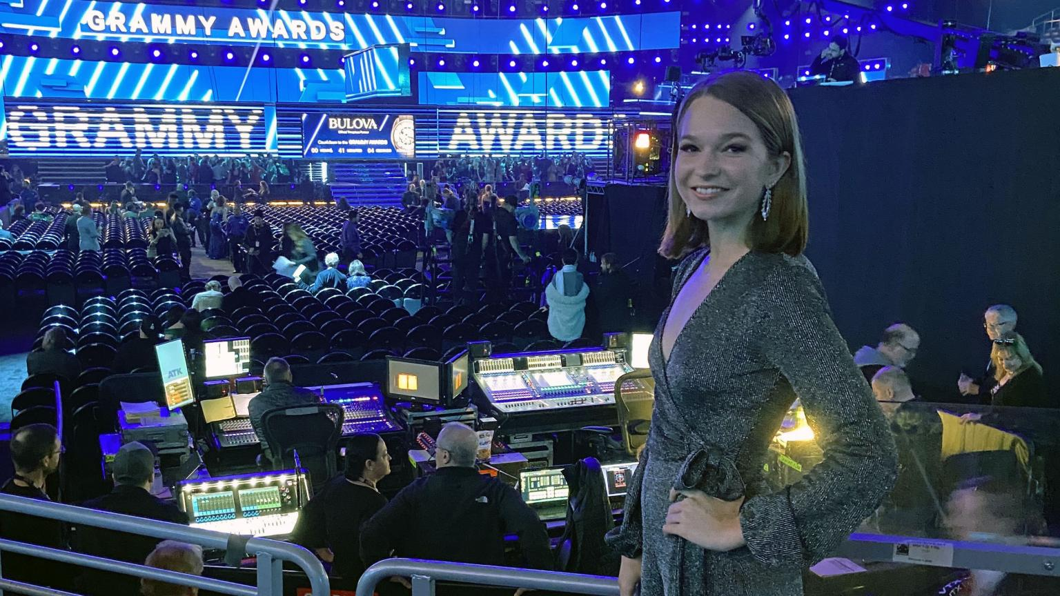 Music Tech Student Ally Stout posing in a dress in front of the stage for the 2020 Grammy Awards.