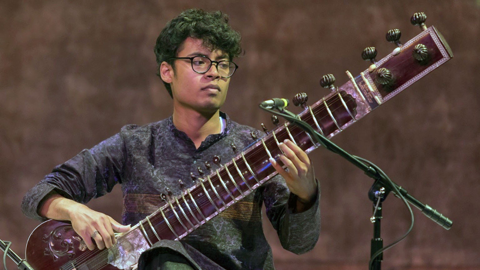 Snehesh Nag, a graduate student, playing a sitar.